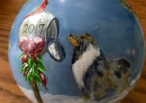 Hand painted Christmas ball with collie looking in the mailbox.