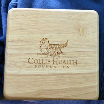 Engraved cutting board with CHF logo for store.