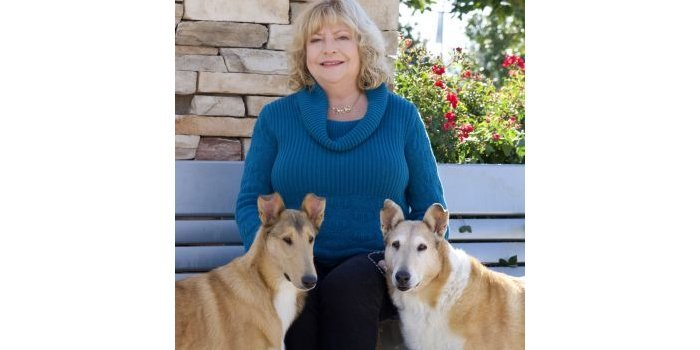 Robette Johns with puppy Jessie and veteran Paris.
